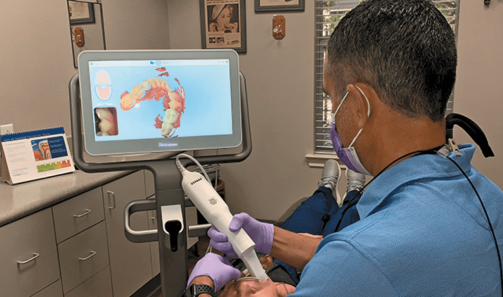 Digital technology used on dental patient.